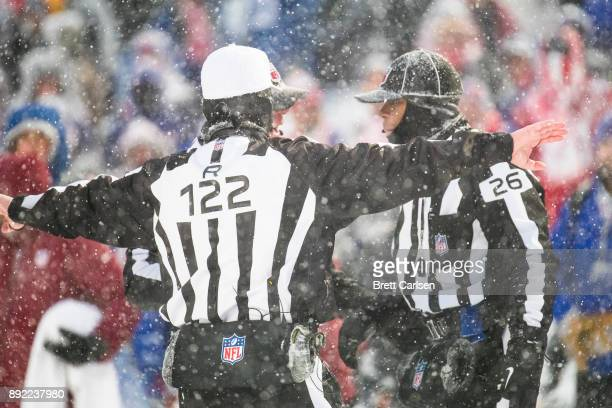 Referees discuss a Indianapolis Colts two point conversion attempt that was called back due to penalty during the fourth quarter against the Buffalo...