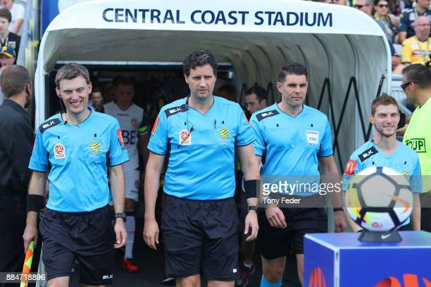 Referees enter the ground before the start of the match LR Lance Greenshields Kris GriffithJones Shaun Evans and James Tesoriero during the round...