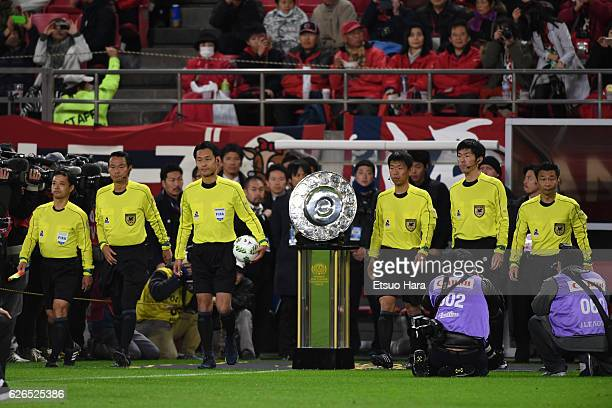 Referees enter the pitch prior to the JLeague Championship Final first leg match between Kashima Antlers and Urawa Red Diamonds at Kashima Soccer...