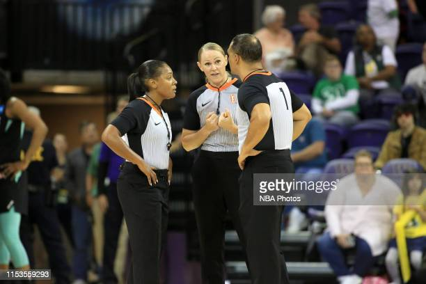 Referees Fatou CissokoStephens Tiffany Bird and Billy Smith talk during the game between the New York Liberty and the Seattle Storm on July 3 2019 at...
