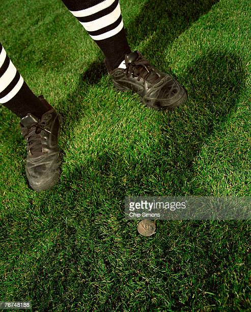 referee's feet and coin on field - flipping a coin stock pictures, royalty-free photos & images