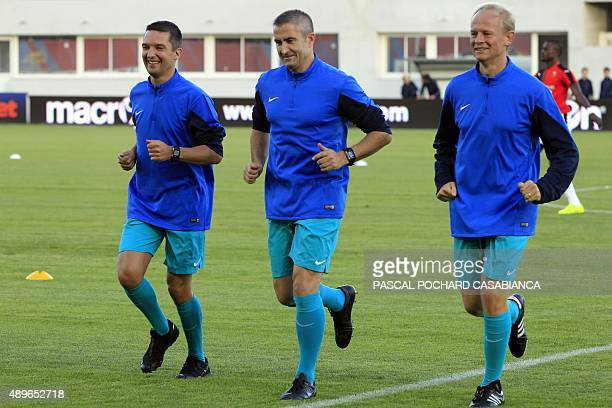 Referees Fredy Frautel , Cyril Gringore and Eric Danizan warm up before the French L1 football match GFC Ajaccio against Rennes on September 23, 2015...