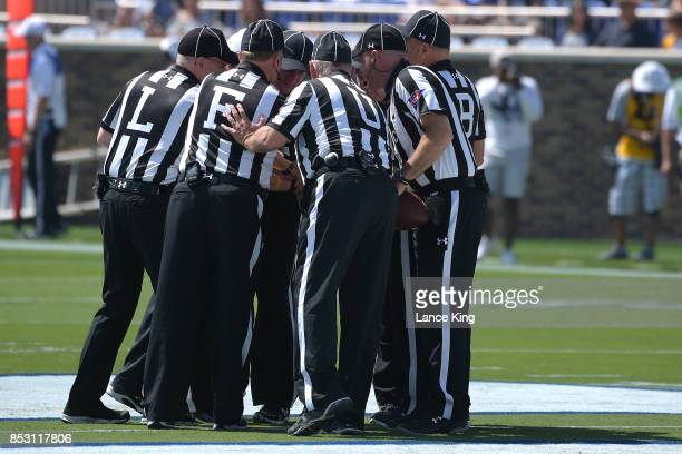 Referees huddle prior to the game between the Northwestern Wildcats and the Duke Blue Devils at Wallace Wade Stadium on September 9 2017 in Durham...