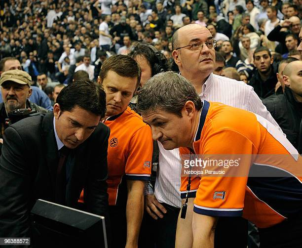Referees Jakub Zamojski Luigo Lamonica and coaches look at TV after the Euroleague Basketball 20092010 Last 16 Game 2 between Partizan Belgrade vs...