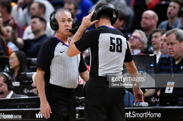 Referees Jason Phillips and Josh Tiven review a play in a NBA game between the Memphis Grizzlies and the Utah Jazz at Vivint Smart Home Arena on...