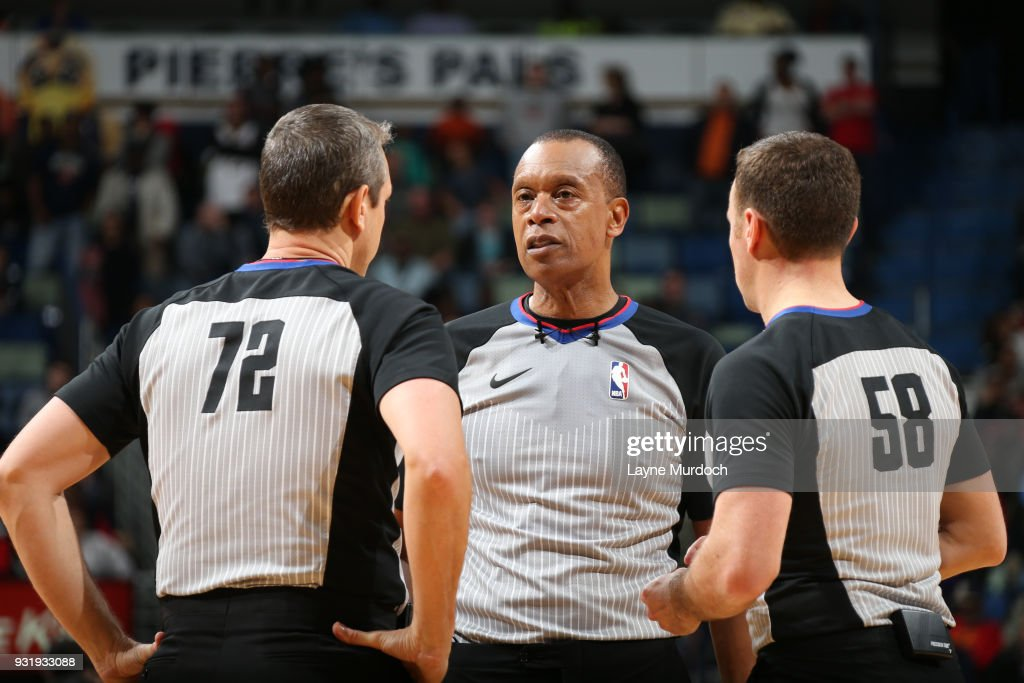 Referees Josh Tiven, Rodney Mott, and J.T. Orr huddle up during the Charlotte Hornets game against the New Orleans Pelicans on March 13, 2018 at Smoothie King Center in New Orleans, Louisiana.
