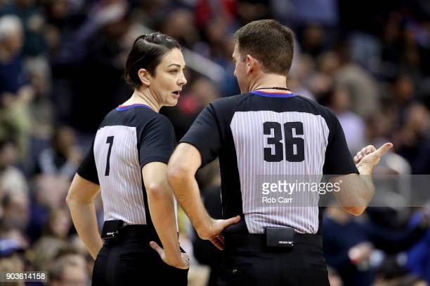 Referees Lauren Holtkamp and David Jones talk during a timeout in the Washington Wizards and Utah Jazz game at Capital One Arena on January 10, 2018...