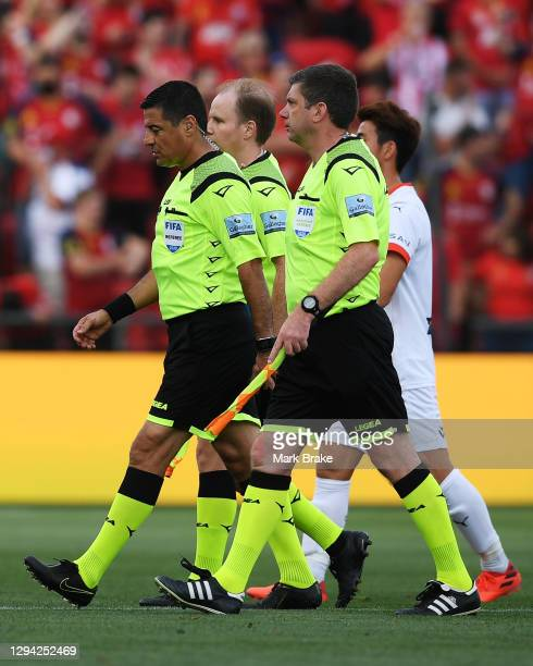 Referees leave ground after the A-League match between Adelaide United and Melbourne City at Coopers Stadium, on January 03 in Adelaide, Australia.