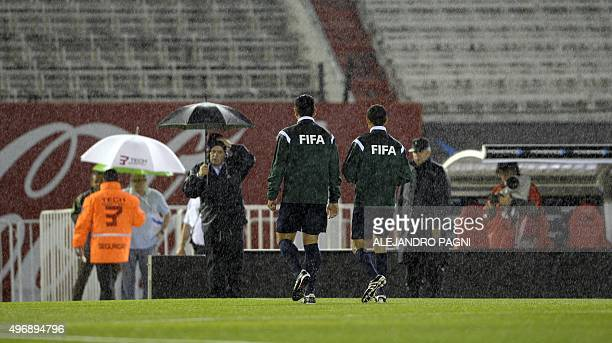 FIFA referees leave the field after the Russia 2018 FIFA World Cup South American Qualifiers football match Argentina vs Brazil was cancelled due to...