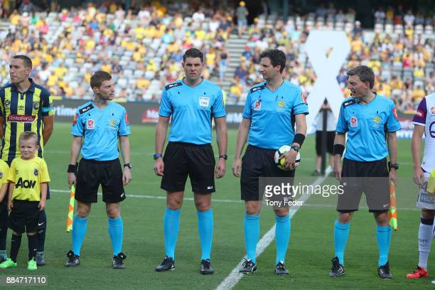 Referees line up before the start of the match LR James Tesoriero Shaun Evans Kris GriffithJones and Lance Greenshields during the round nine ALeague...
