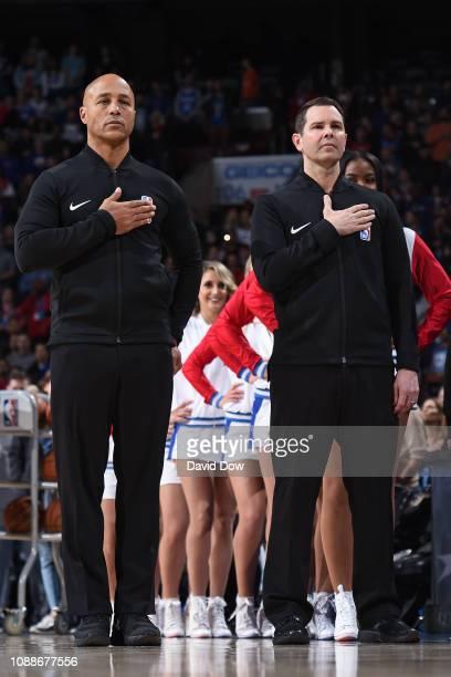 Referees Marc Davis and Brian Forte stand for the national anthem prior to the game between the Oklahoma City Thunder and Philadelphia 76ers on...