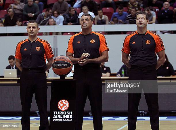 Referees Marcin Kowalski Dani Hierrezuelo and Arnis Ozols are seen before the 20142015 Turkish Airlines Euroleague Basketball Regular Season Date 6...