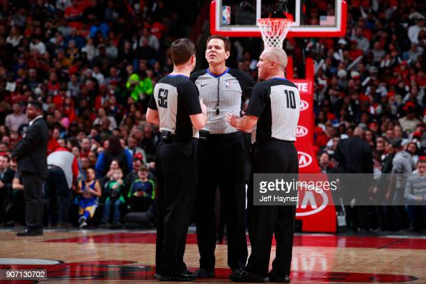 Referees Mark Ayotte Ron Garretson and Scott Twardoski huddle up during the game between the Golden State Warriors and the Chicago Bulls on January...