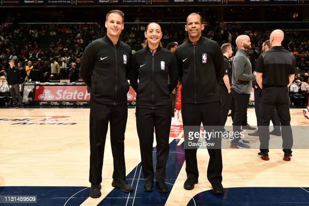 Referees Mark Lindsay Ashley MoyerGleich and Eric Lewis pose for a photo before the game between the Washington Wizards and the Utah Jazz on March 18...