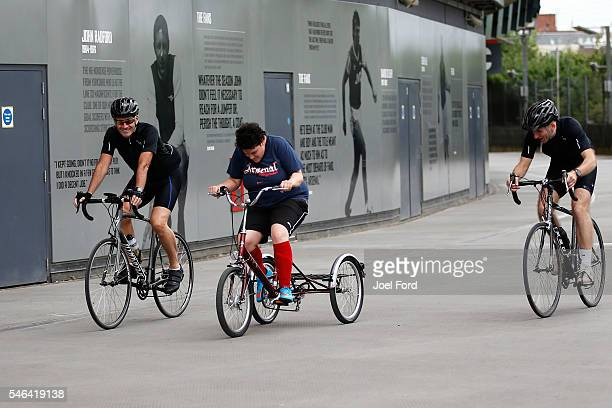 Referees Martin Atkinson and Mike Riley rides with children involved with Pedal Power Cycling Club at Emirates Stadium during the Premier League...