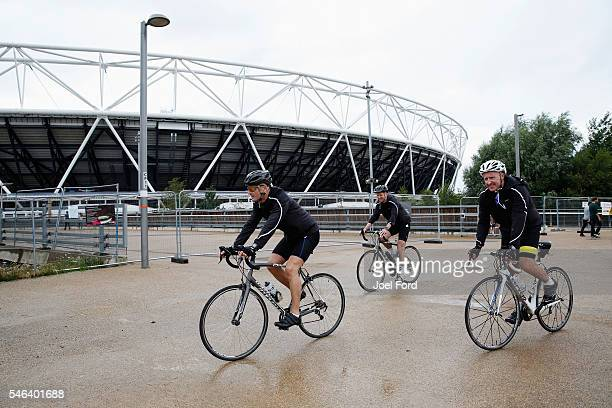 Referees Martin Atkinson Mike Riley and Jon Moss cycle past the Olympic Stadium during the Premier League Referees Charity Bike Ride on July 12 2016...
