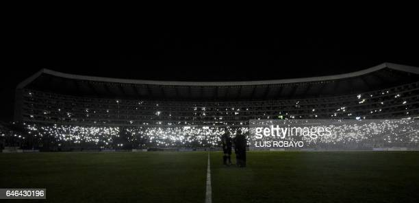 Referees meet during a blackout during the Sudamericana Cup match between Colombia's Deportivo Cali and Paraguay's Sportivo Luqueno at the Deportivo...