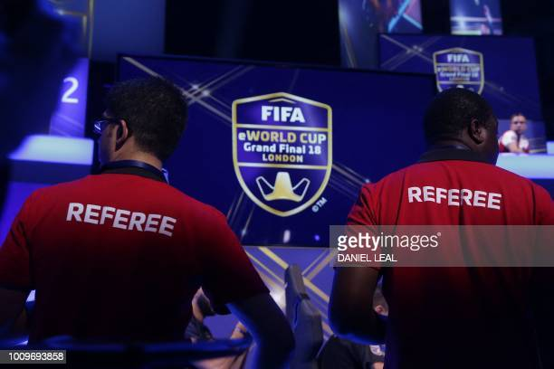 Referees monitor the play as players compete on Microsoft Xbox and Sony Playstation games consoles in the group stages of the FIFA eWorld Cup Grand...