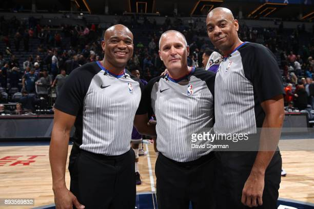 Referees Monty McCutchen Tre Maddox and Karl Lane pose for a photo before the game against the Sacramento Kings on December 14 2017 at Target Center...