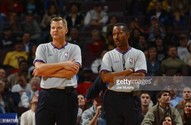 Referees observe the game between the Utah Jazz and the Detroit Pistons during the preseason game at The Palace of Auburn Hills on October 24 2004 in...