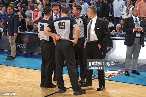Referees: Pat Fraher, Ben Taylor and Mark Lindsay huddle up with Quin Snyder of the Utah Jazz and Billy Donovan of the Oklahoma City Thunder before...
