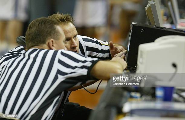 Referees review the last second shot of regulation to determine if it was a three point or a two point shot during the 2005 NCAA division 1 men's...