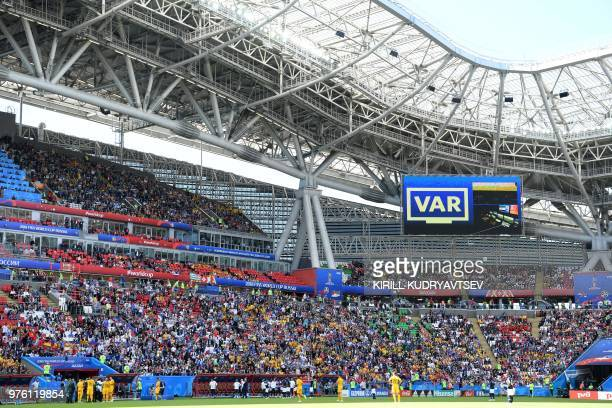 Referees review the video replay during the Russia 2018 World Cup Group C football match between France and Australia at the Kazan Arena in Kazan on...