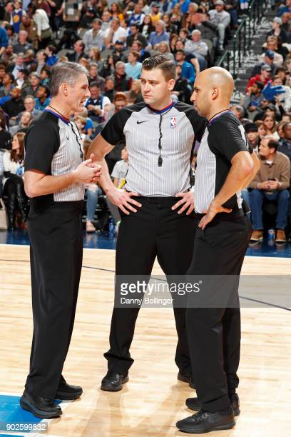 Referees Scott Foster Aaron Smith and Gediminas Petraitis huddle during the Golden State Warriors game against the Dallas Mavericks on January 3 2018...