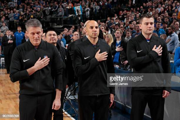 Referees Scott Foster Aaron Smith and Gediminas Petraitis stand on the court for the National Anthem before the Golden State Warriors game against...