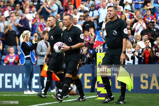 Referee's Scott Ledger Kevin Friend and Andrew Garratt walk out onto the pitch during the Premier League match between Crystal Palace and Aston Villa...