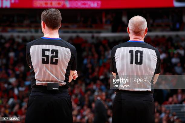 Referees Scott Twardoski and Ron Garretson stand on the court during the game between the Golden State Warriors and the Chicago Bulls on January 17...