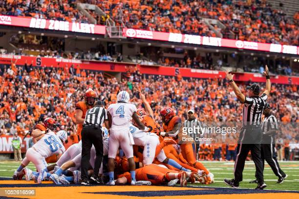 Referees signal touchdown as Chris Elmore of the Syracuse Orange carries the ball during the second quarter against the North Carolina Tar Heels at...
