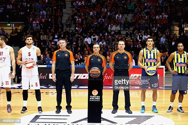 Referees Sretan Radovic Fernando Rocha and Seregy Zashchuk and players are seen before the start of the 20142015 Turkish Airlines Euroleague...