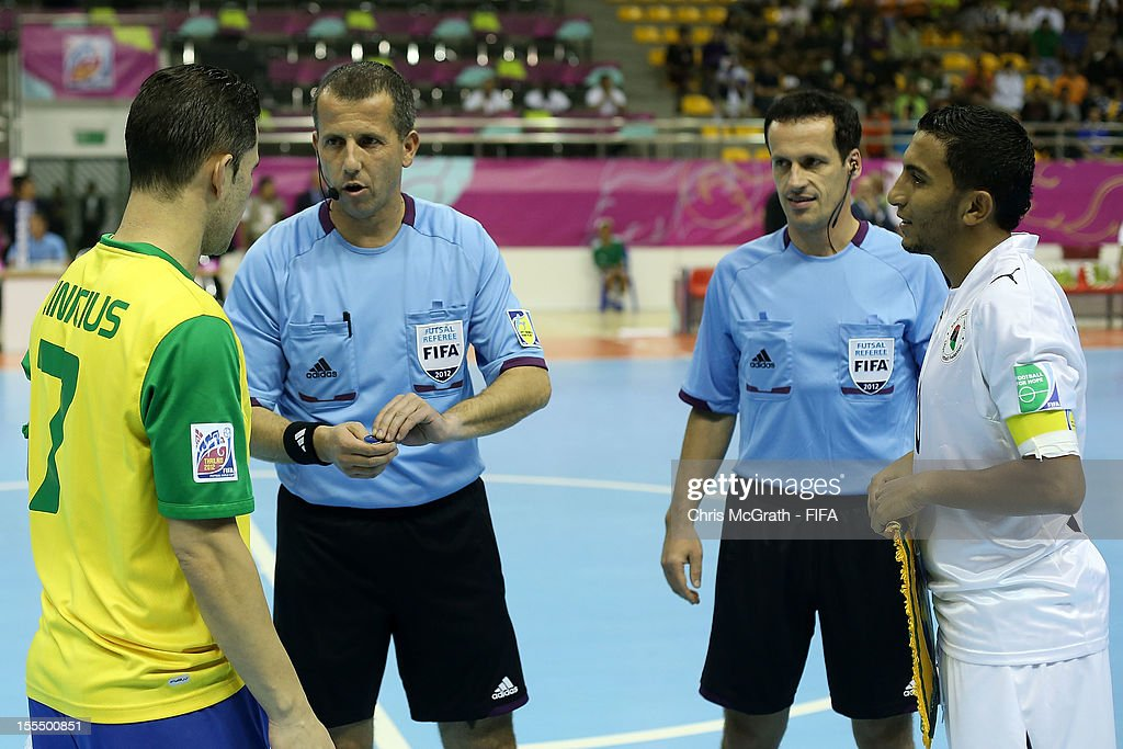 Referees stage the coin toss during the FIFA Futsal World Cup, Group C match between Brazil and Libya at Korat Chatchai Hall on November 4, 2012 in Nakhon Ratchasima, Thailand.