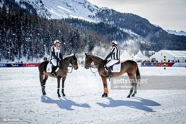 Referees stand on the pitch during the Snow Polo World Cup 2015 on February 1 2015 in St Moritz Switzerland