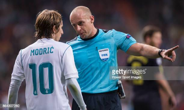 Referees Szymon Marciniak talks with Luka Modric of Real Madrid during the UEFA Champions League 2017-18 match between Real Madrid and Tottenham...