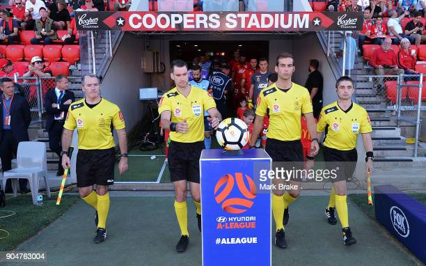 Referees take the ball at the start of the round 16 ALeague match between Adelaide United and Sydney FC at Coopers Stadium on January 14 2018 in...