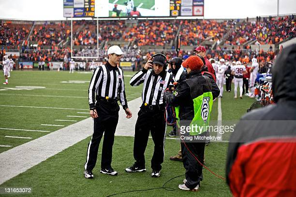 Referee's talk on headsets during a instant replay review during a game between the Oregon State Beavers and the Stanford Cardinal on November 5,...