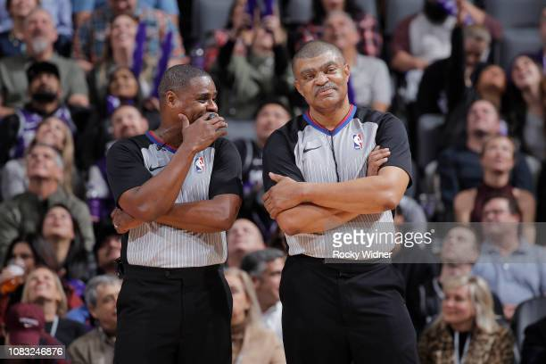 NBA referees Tony Brothers and Leroy Richardson look on during the game between the Detroit Pistons and Sacramento Kings on January 10 2019 at Golden...