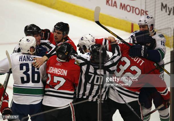 Referees try to break up a fight between members of the Chicago Blackhawks including Ryan Johnson Chris Campoli and John Scott with members of the...