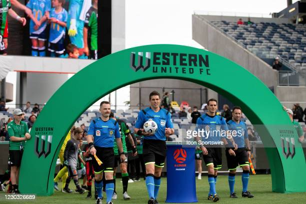 Referees walk onto the field during the Hyundai A-League soccer match between Western United FC and Adelaide United on December 28, 2020 at GMHBA...