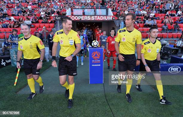 Referees walk onto the pitch during the round 16 ALeague match between Adelaide United and Sydney FC at Coopers Stadium on January 14 2018 in...