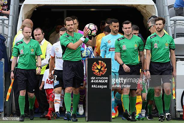 Referees walk out on the ground during the round 11 ALeague match between the Central Coast Mariners and Brisbane Roar at Central Coast Stadium on...