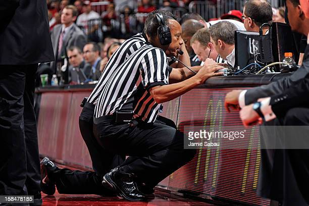 Referees watch a replay during a game between the Ohio State Buckeyes and the UNC Asheville Bulldogs on December 15 2012 at Value City Arena in...