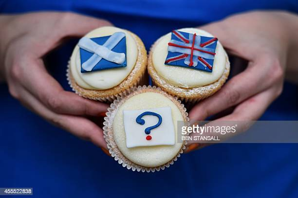 'Referendum cupcakes' featuring a Scottish Saltire a Union flag and a question mark symbolising the 'undecided voter' are pictured at a bakery in...