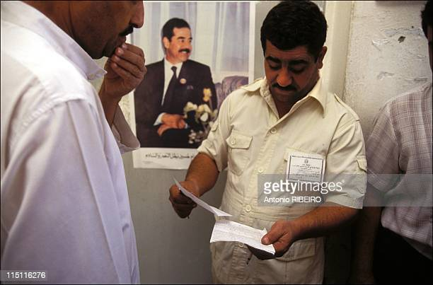 Referendum under UN embargo in Baghdad Iraq in October 1995 Saddam's Baath party member with a voter