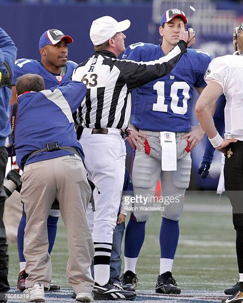 Referree Bill Carollo coin toss prior to the New York Giants 30 to 7 loss to the New Orleans Saints on December 24 2006 at Giants Stadium in East...