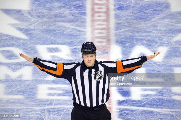 Referree Trevor Hanson signals no goal after video review by officials on a Toronto Maple Leafs shot by Austin Mathews during the regular season NHL...