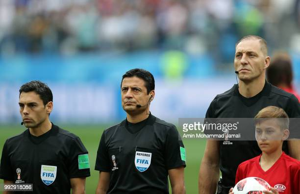 Refferees Juan Pablo Belatti Alireza Faghani of Iran and Nestor Pitana of Argentina line up prior to the 2018 FIFA World Cup Russia Quarter Final...