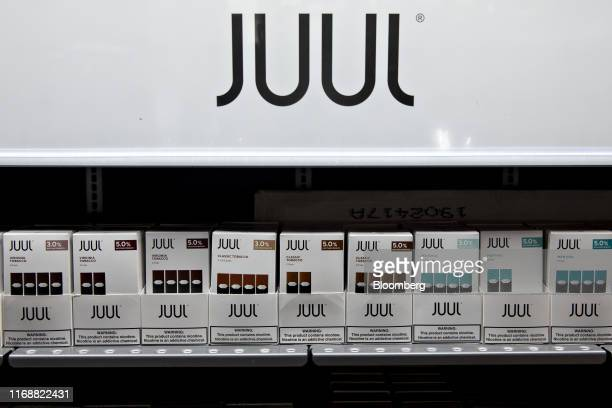 Refill pods for Juul Labs Inc. E-cigarettes are displayed for sale at a store in Princeton, Illinois, U.S., on Monday, Sept. 16, 2019. Faced with a...